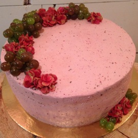 Chocolate berry cake with berry butter cream icing, grapes and fondant flowers.