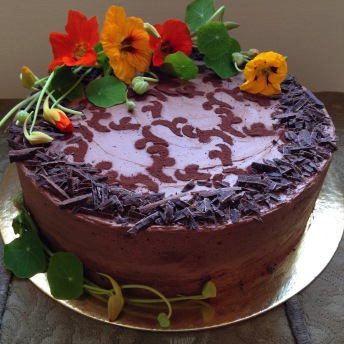 Triple chocolate cake with nasturtium flowers