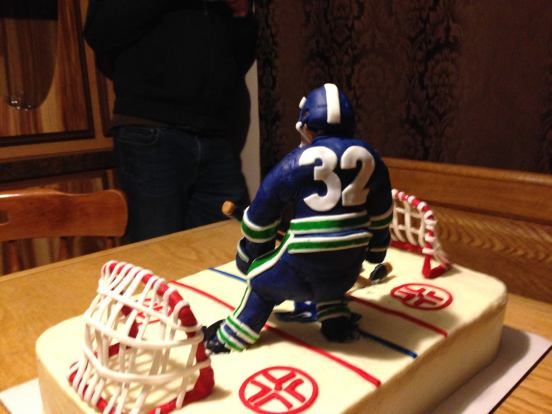 Vanilla raspberry Canucks Hockey cake
