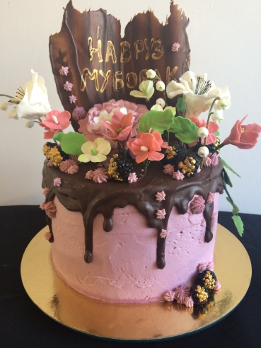Vanilla cream cake with pink buttercream chocolate and fondant flowers