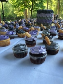 Purple and grey themed wedding, chocolate cake with 180 chocolate ganesh filling and grey and purple buttercream rose, with matching cupcakes, triple chocolate, vanilla strawberry and tiramisu flavour cupcakes.