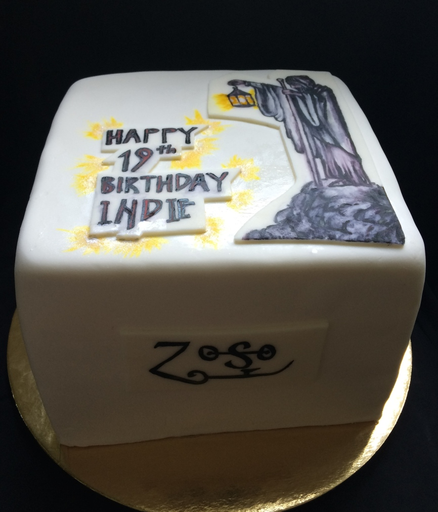 Led Zeppelin cake, lemon blueberry with lemon curd, blueberriesl, lemon buttercream and homemade fondant with hand painted wizard and symbols from Led Zeppelin