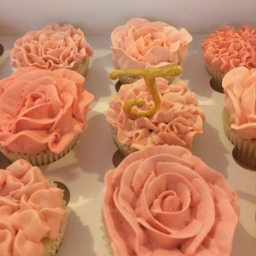 Gluten free lemon cupcakes with pink and peach coloured lemon buttercream flowers