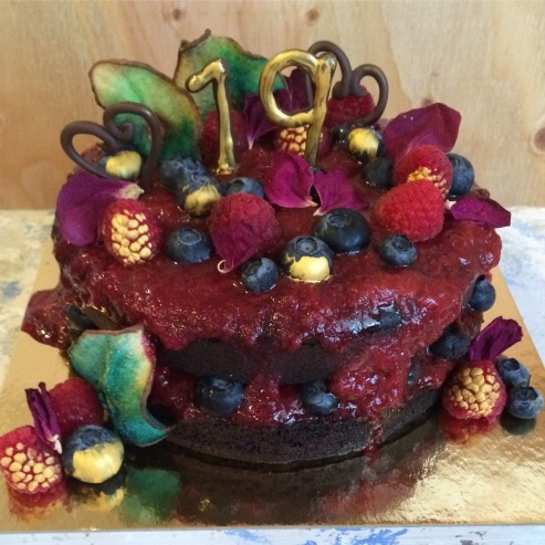 Vegan chocolate cake with berries, ombre died dried pears and rose pedals.