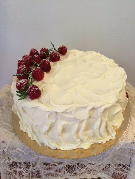 Light and fluffy vanilla sponge cake with mascarpone cheese and whip cream filling a raspberry compote with brandy and white chocolate buttercream