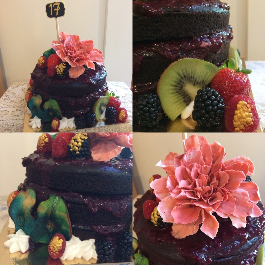Vegan chocolate cake with mixed berry compote, ombre dried pears, fresh fruit, coconut cream and a gum past dahlia flower