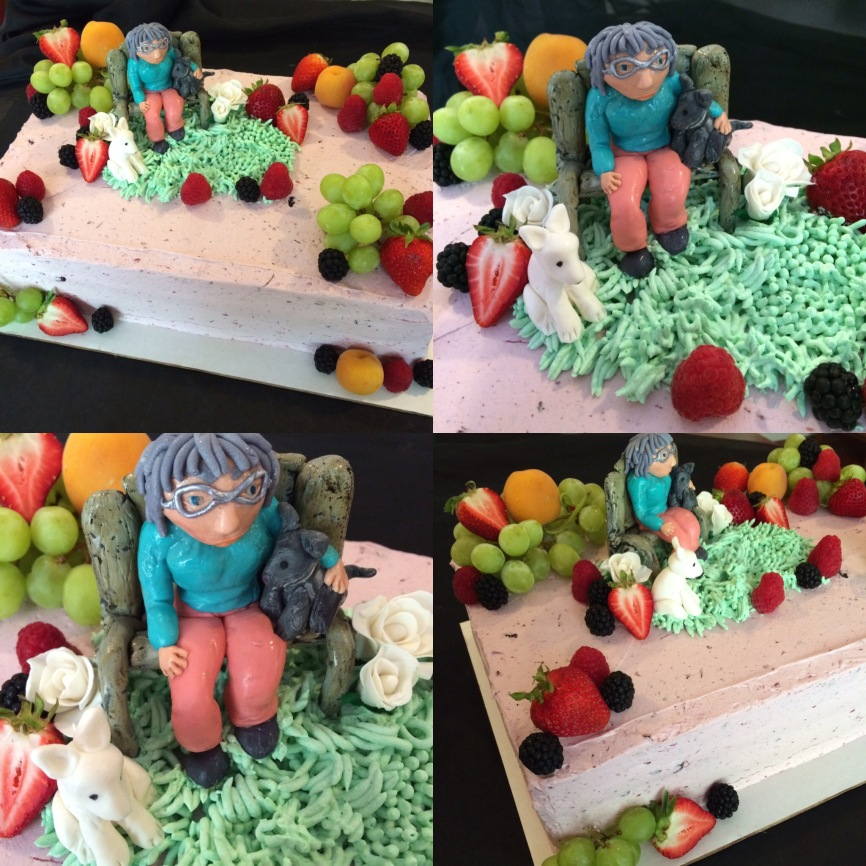An old lady on a bench with her kitty and dog on a mixed berry cake with fresh fruit