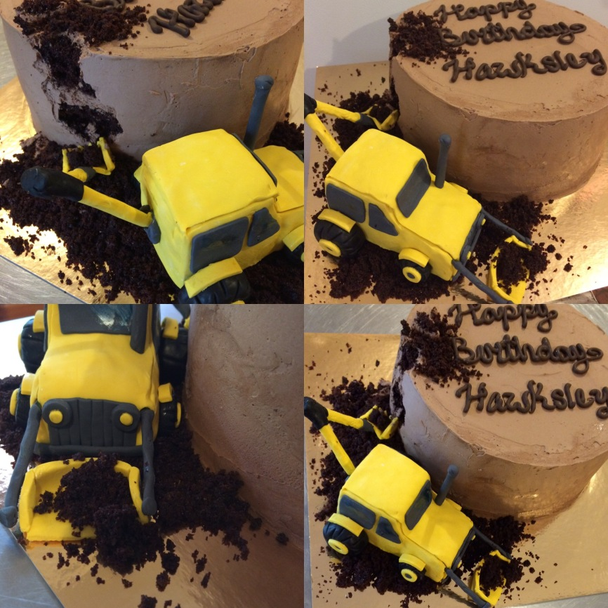 Chocolate strawberry cake with a fondant backhoe.