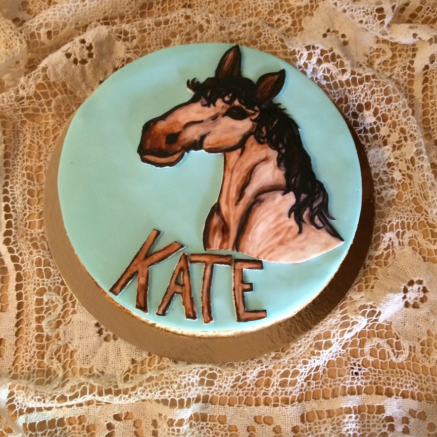 New York cheesecake with a fondant hand painted horse.