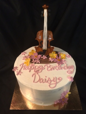 Violin cake, chocolate raspberry cake with buttercream vanilla, a handmade found and gum past, violin and handmade flowers