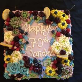 Buttercream flowers and fresh fruit birthday cake
