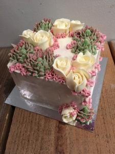 Buttercream succulents roses wedding cake