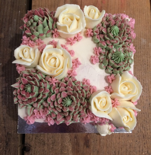 Buttercream succulents roses wedding cake