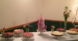 Strawberry Lemon wedding cake with strawberry cream cheese icing fresh sweet pea flowers and lavender and cupcakes