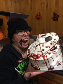 Friday the 13th, a spit cake with a pumpkin cheesecake center and a handmade fondant Jason mask and machete.