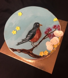 Lemon raspberry cake with a hand painted robin
