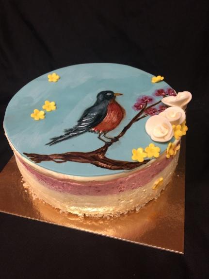 Lemon raspberry cake with a hand painted robin