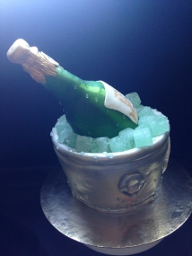 Champagne bottle in a bucket of ice cake