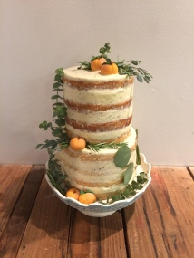 Gluten Free rosemary and peach naked wedding cake with handmade fondant peaches