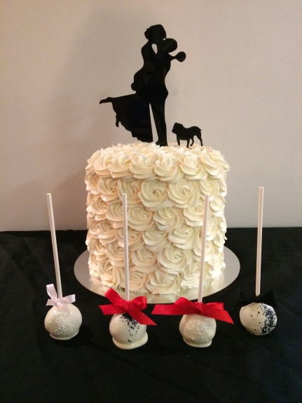 White buttercream rose wedding cake with matching cake pops
