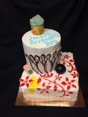 Hand holding penes cake