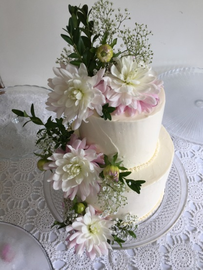 Simple white buttercream cake with fresh flowers