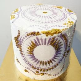 Buttercream stencil cake with gold accents