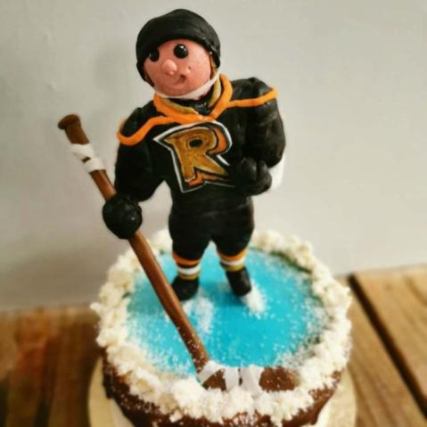 Hockey player cake with hand sculpted player