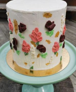Buttercream flower cake with gold accents