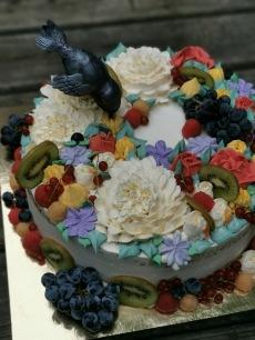 hummingbird cake with buttercream flowers and fresh fruit