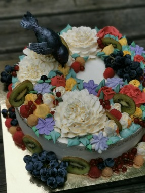 hummingbird cake with buttercream flowers and fresh fruit