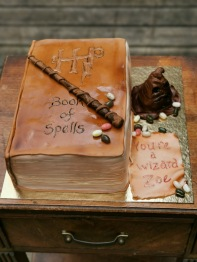 "Harry Potter 'Book of Spells"" cake with handmade fondant details"