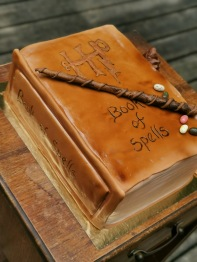 "Harry Potter ""book of spells"" cake with handmade fondant details"