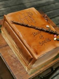 "Harry Potter ""book of spells"" cake with handmade fondant details"