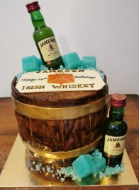 Whiskey barrel cake with handmaid fondant details
