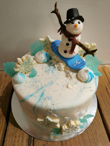 Snowboarding snowman cake with handmaid fondant details